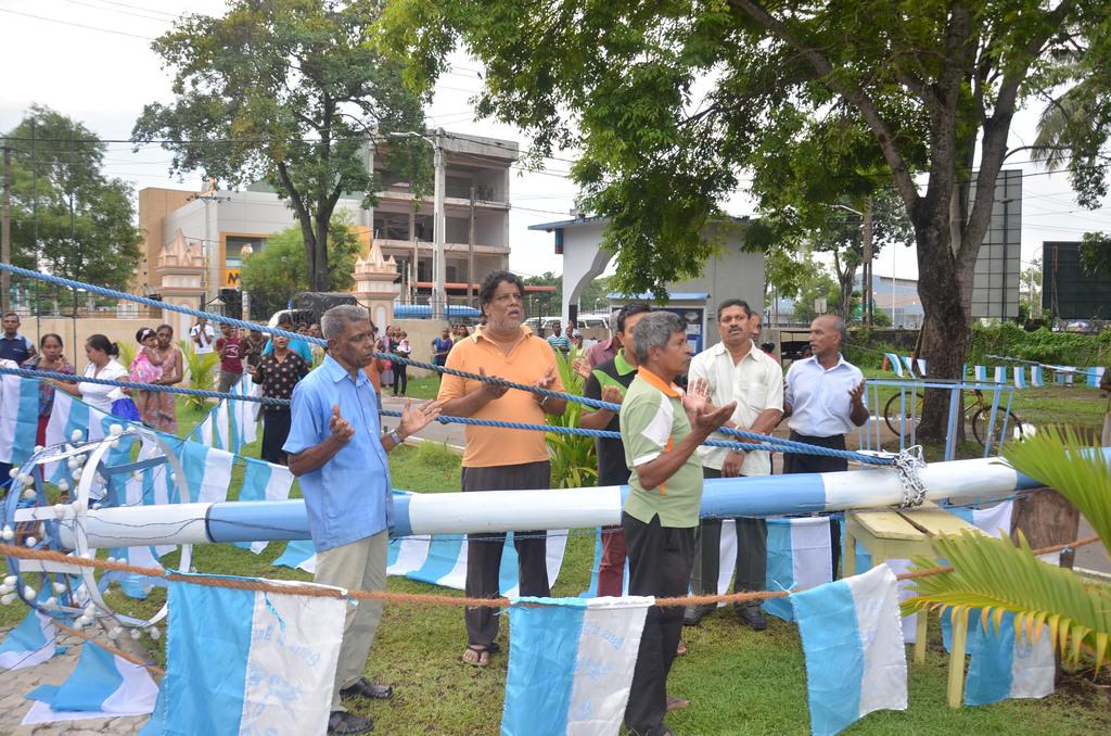 Hoisting the Feast Flag of the Queen of Angels' Church - Rawathawatta